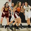 Trisha Harrison looks for na open Redwoods teammate as the Butte College basketball team plays Saturday, Jan. 14, 2017, against College of the Redwoods in Butte Valley, California. (Dan Reidel -- Enterprise-Record)