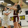 Redwoods player Braelynn Rose, center, gets her fingertips on the ball as she fights for a rebound with Butte College Roadrunners Jessica Curl, left, and Abby Manley, right, as the Butte College basketball team plays Saturday, Jan. 14, 2017, against College of the Redwoods in Butte Valley, California. (Dan Reidel -- Enterprise-Record)