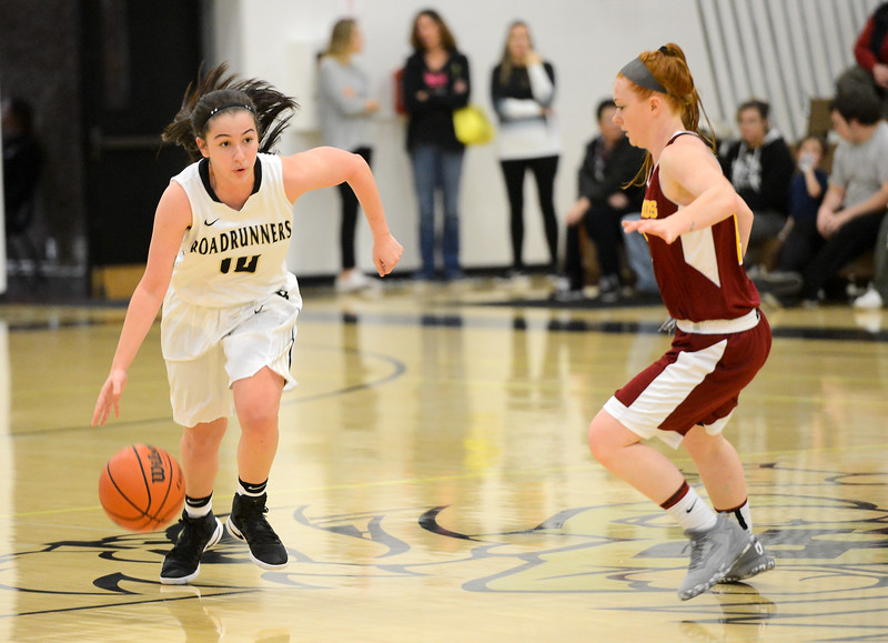 Butte College's Jessica Maglietta, left, drives downcourt against Paige Legaz, right, as the Butte College basketball team plays Saturday, Jan. 14, 2017, against College of the Redwoods in Butte Valley, California. (Dan Reidel -- Enterprise-Record)