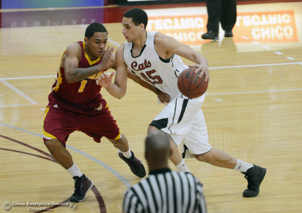 . Chico State\'s #15 Amir Carraway (right) dribbles against Cal State Dominguez Hills\' #1 Chris Carvin (left) in the first half of their men\'s basketball game at CSUC Acker Gym Friday, January 10, 2014 in Chico, Calif.  (Jason Halley/Chico Enterprise-Record)