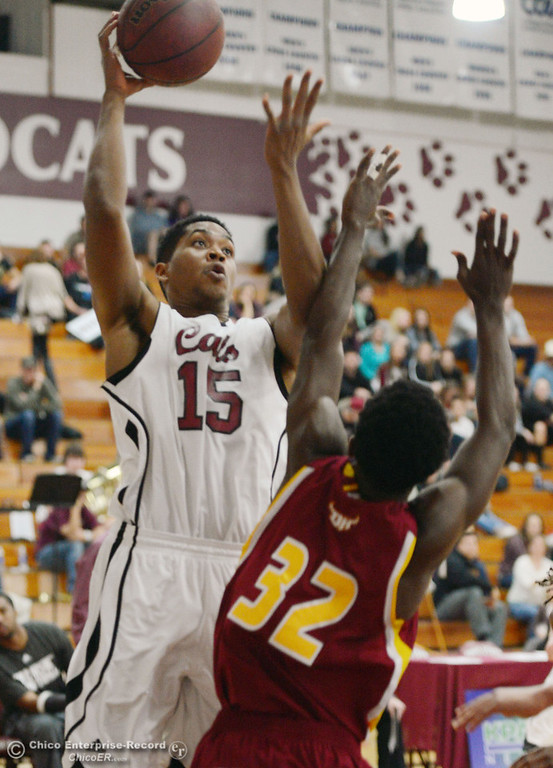 . Chico State\'s #15 Amir Carraway (left) goes up for a shot against Cal State Dominguez Hills\' #32 Everett Turner (right) in the first half of their men\'s basketball game at CSUC Acker Gym Friday, January 10, 2014 in Chico, Calif.  (Jason Halley/Chico Enterprise-Record)