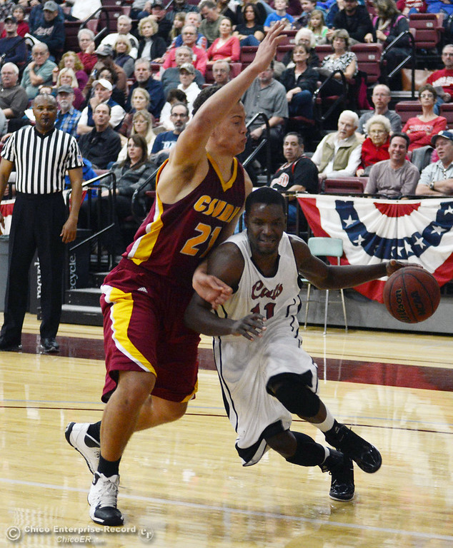. Chico State\'s #11 Rashad Parker (right) dribbles against Cal State Dominguez Hills\' #21 Justin Sadler (left) in the first half of their men\'s basketball game at CSUC Acker Gym Friday, January 10, 2014 in Chico, Calif.  (Jason Halley/Chico Enterprise-Record)