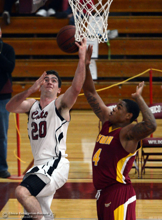 . Chico State\'s #20 Sean Park (left) goes up for a shot against Cal State Dominguez Hills\' #4 Darnell Martin (right) in the first half of their men\'s basketball game at CSUC Acker Gym Friday, January 10, 2014 in Chico, Calif.  (Jason Halley/Chico Enterprise-Record)