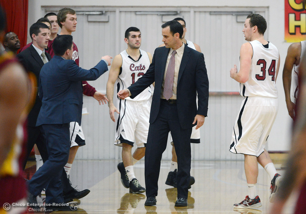 . Chico State head coach Greg Clink takes a timeout against Cal State Dominguez Hills in the first half of their men\'s basketball game at CSUC Acker Gym Friday, January 10, 2014 in Chico, Calif.  (Jason Halley/Chico Enterprise-Record)