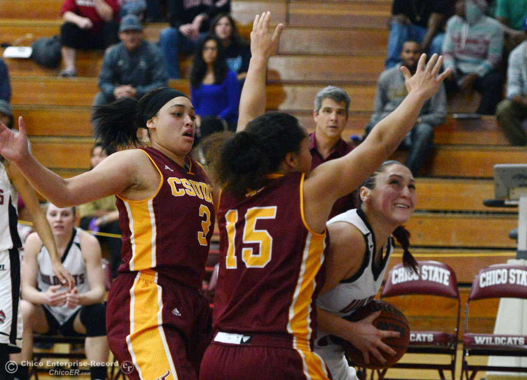. Chico State\'s #30 McKenzie Dalthorp (right) goes up for a shot against Cal State Dominguez Hills\' #15 Monay Lee (center) and #3 Tayler Champion (left) in the second half of their women\'s basketball game at CSUC Acker Gym Friday, January 10, 2014 in Chico, Calif.  (Jason Halley/Chico Enterprise-Record)