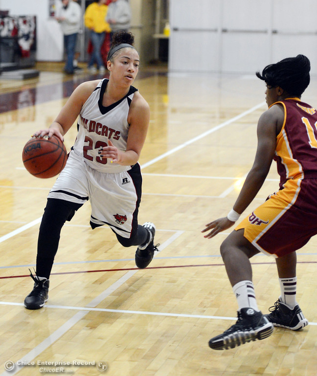. Chico State\'s #23 Jazmine Miller (left) dribbles against Cal State Dominguez Hills\' #10 Simone Thompson (right) in the second half of their women\'s basketball game at CSUC Acker Gym Friday, January 10, 2014 in Chico, Calif.  (Jason Halley/Chico Enterprise-Record)