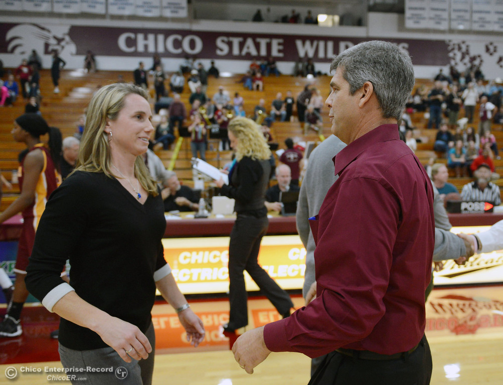 . Former Chico State coach and current Cal State Dominguez Hills\' head coach Molly Goodenbour (left) hugs Chico State head coach Brian Fogel (right) after their women\'s basketball game at CSUC Acker Gym Friday, January 10, 2014 in Chico, Calif.  (Jason Halley/Chico Enterprise-Record)