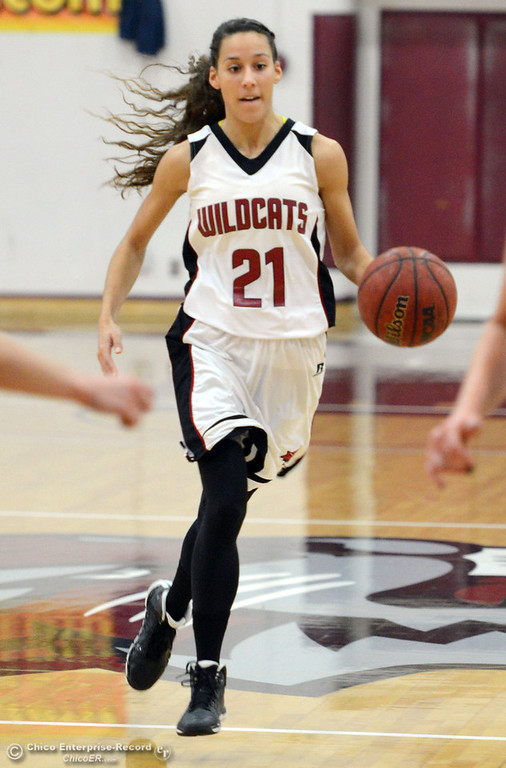 . Chico State\'s #21 Courtney Hamilton dribbles against Cal State L.A. in the first half of their women\'s basketball game at CSUC Acker Gym Saturday, January 11, 2014 in Chico, Calif.  (Jason Halley/Chico Enterprise-Record)
