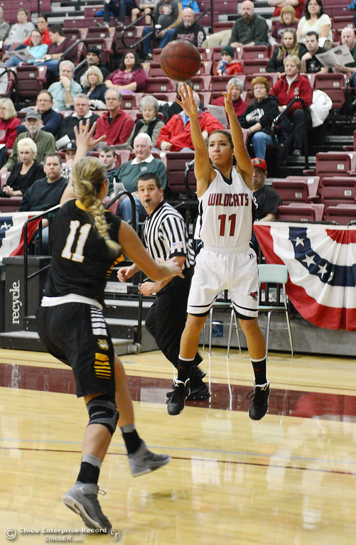 . Chico State\'s #11 Hannah Womack (right) takes a shot against Cal State L.A.\'s #11 Bree Parsons (left) in the first half of their women\'s basketball game at CSUC Acker Gym Saturday, January 11, 2014 in Chico, Calif.  (Jason Halley/Chico Enterprise-Record)