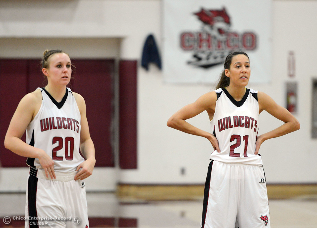 . Chico State\'s #20 Annie Ward (left) and #21 Courtney Hamilton (right) look on against Cal State L.A. in the first half of their women\'s basketball game at CSUC Acker Gym Saturday, January 11, 2014 in Chico, Calif.  (Jason Halley/Chico Enterprise-Record)