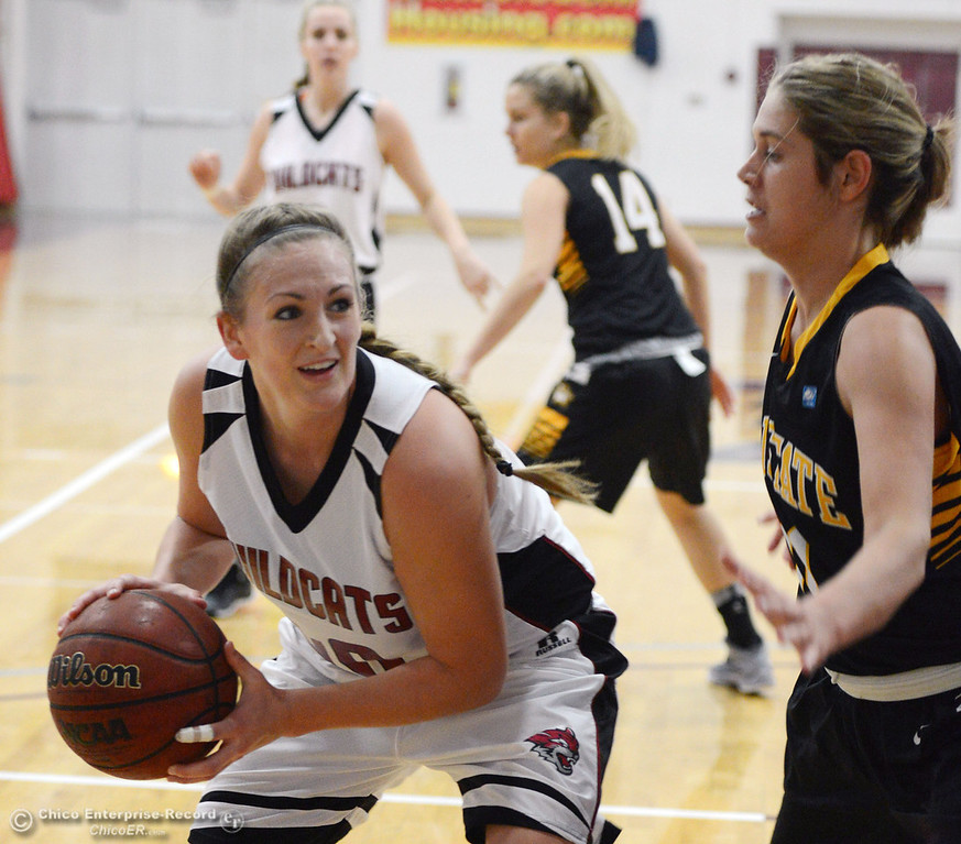 . Chico State\'s #40 Analise Riezebos (left) dribbles against Cal State L.A.\'s #11 Bree Parsons (right) in the first half of their women\'s basketball game at CSUC Acker Gym Saturday, January 11, 2014 in Chico, Calif.  (Jason Halley/Chico Enterprise-Record)