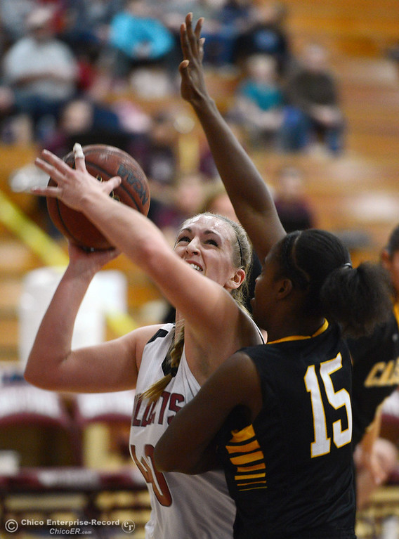 . Chico State\'s #40 Analise Riezebos (left) goes up for a shot against Cal State L.A.\'s #15 Alisha Belt (right) in the first half of their women\'s basketball game at CSUC Acker Gym Saturday, January 11, 2014 in Chico, Calif.  (Jason Halley/Chico Enterprise-Record)