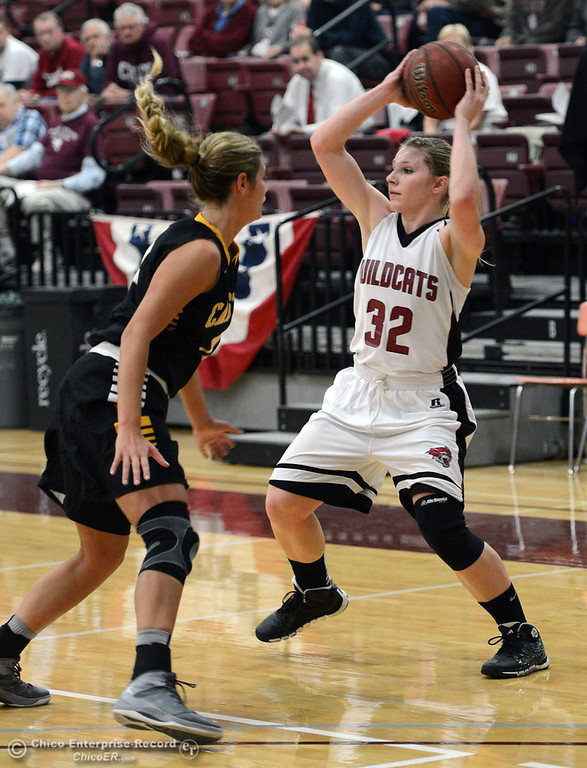 . Chico State\'s #32 Michelle Walker (right) looks to pass against Cal State L.A.\'s #11 Bree Parsons (left) in the first half of their women\'s basketball game at CSUC Acker Gym Saturday, January 11, 2014 in Chico, Calif.  (Jason Halley/Chico Enterprise-Record)
