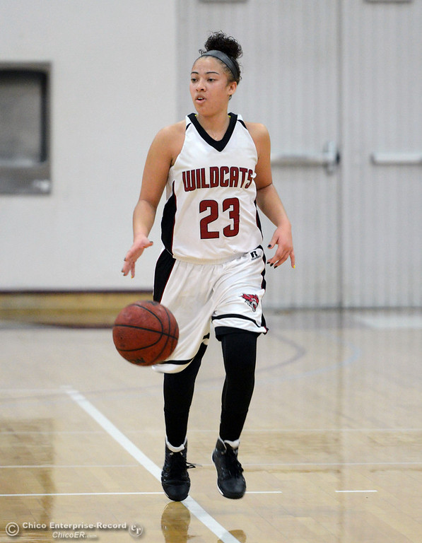 . Chico State\'s #23 Jazmine Miller dribbles against Cal State L.A. in the first half of their women\'s basketball game at CSUC Acker Gym Saturday, January 11, 2014 in Chico, Calif.  (Jason Halley/Chico Enterprise-Record)