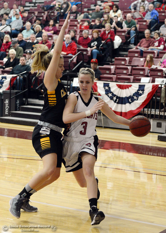 . Chico State\'s #3 Tyler Prange (right) dribbles against Cal State L.A.\'s #14 Georgia Williams (left) in the first half of their women\'s basketball game at CSUC Acker Gym Saturday, January 11, 2014 in Chico, Calif.  (Jason Halley/Chico Enterprise-Record)