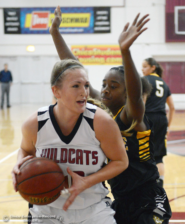 . Chico State\'s #40 Analise Riezebos (left) dribbles against Cal State L.A.\'s #15 Alisha Belt (right) in the first half of their women\'s basketball game at CSUC Acker Gym Saturday, January 11, 2014 in Chico, Calif.  (Jason Halley/Chico Enterprise-Record)