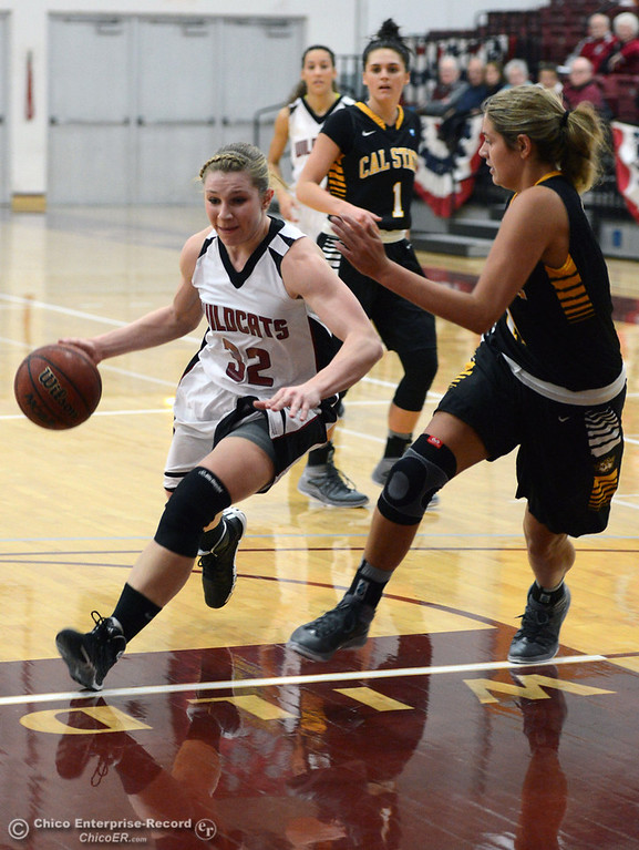 . Chico State\'s #32 Michelle Walker (left) dribbles against Cal State L.A.\'s #11 Bree Parsons (right) in the first half of their women\'s basketball game at CSUC Acker Gym Saturday, January 11, 2014 in Chico, Calif.  (Jason Halley/Chico Enterprise-Record)