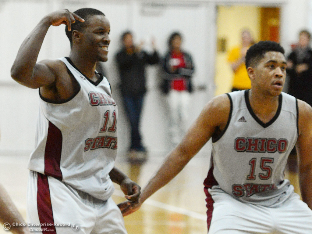 . Chico State\'s #11 Rashad Parker (left) reacts to making a free throw next to #15 Amir Carraway (right) against Cal State San Bernardino in overtime of their men\'s basketball game at CSUC Acker Gym Saturday, February 8, 2014 in Chico, Calif.  (Jason Halley/Chico Enterprise-Record)
