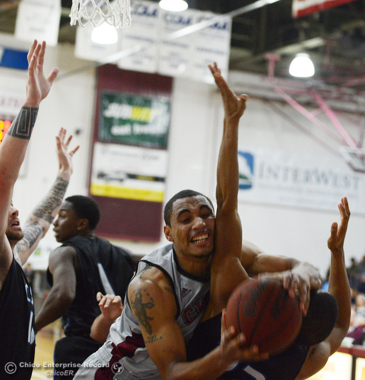 . Chico State\'s #41 Jordan Barton (left) collides against Cal State San Bernardino\'s #22 Joshua Gouch (right) in the second half of their men\'s basketball game at CSUC Acker Gym Saturday, February 8, 2014 in Chico, Calif.  (Jason Halley/Chico Enterprise-Record)