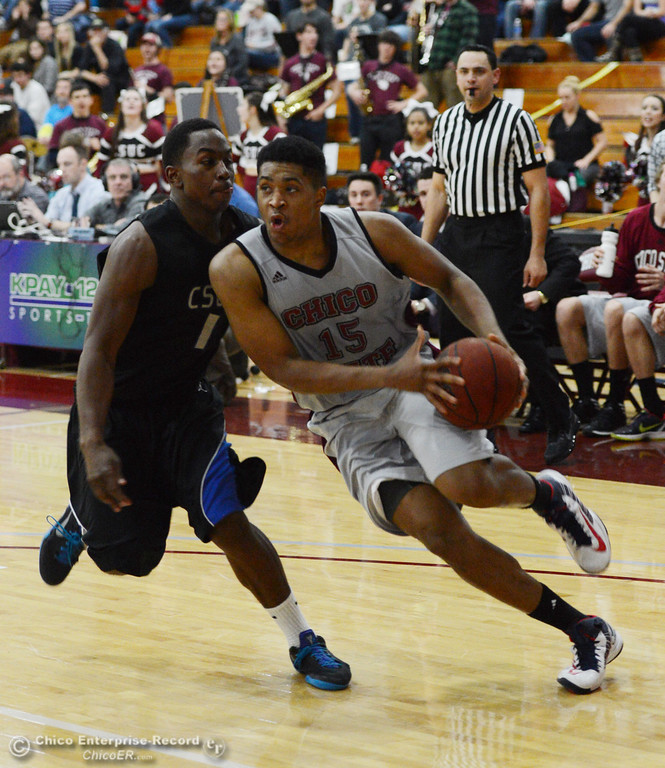 . Chico State\'s #15 Amir Carraway (right) dribbles against Cal State San Bernardino\'s #1 Kirby Gardner (left) in overtime of their men\'s basketball game at CSUC Acker Gym Saturday, February 8, 2014 in Chico, Calif.  (Jason Halley/Chico Enterprise-Record)