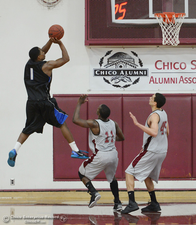 . Chico State\'s #45 Jordan Semple (right) and #11 Rashad Parker (center) attempt to block against Cal State San Bernardino\'s #1 Kirby Gardner (left) in the second half of their men\'s basketball game at CSUC Acker Gym Saturday, February 8, 2014 in Chico, Calif.  (Jason Halley/Chico Enterprise-Record)