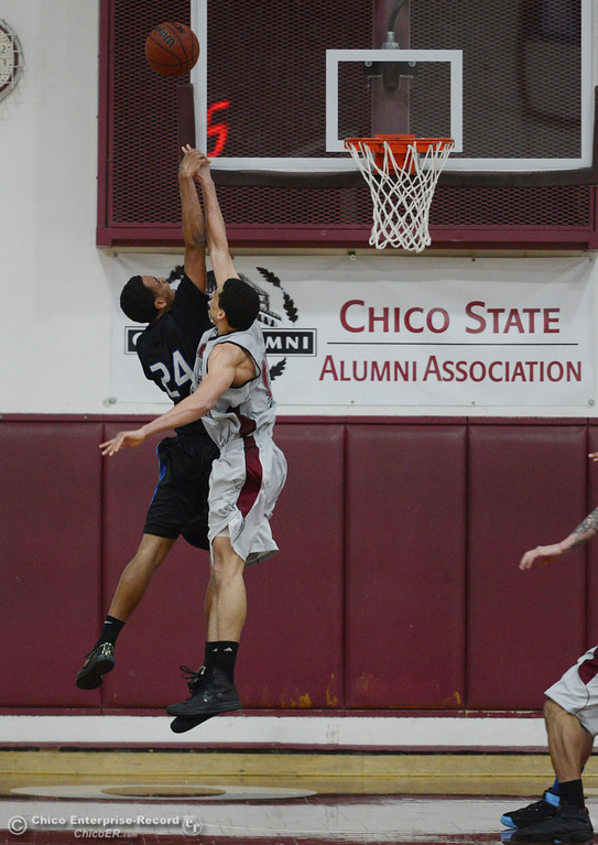 . Chico State\'s #45 Jordan Semple (right) fouls against Cal State San Bernardino\'s #24 Jordan Burris (left) going up for a shot in overtime of their men\'s basketball game at CSUC Acker Gym Saturday, February 8, 2014 in Chico, Calif.  (Jason Halley/Chico Enterprise-Record)