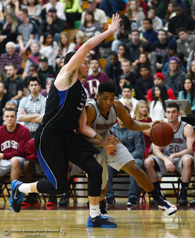 . Chico State\'s #15 Amir Carraway (right) dribbles against Cal State San Bernardino\' #32 Taylor Statham (left) in the second half of their men\'s basketball game at CSUC Acker Gym Saturday, February 8, 2014 in Chico, Calif.  (Jason Halley/Chico Enterprise-Record)