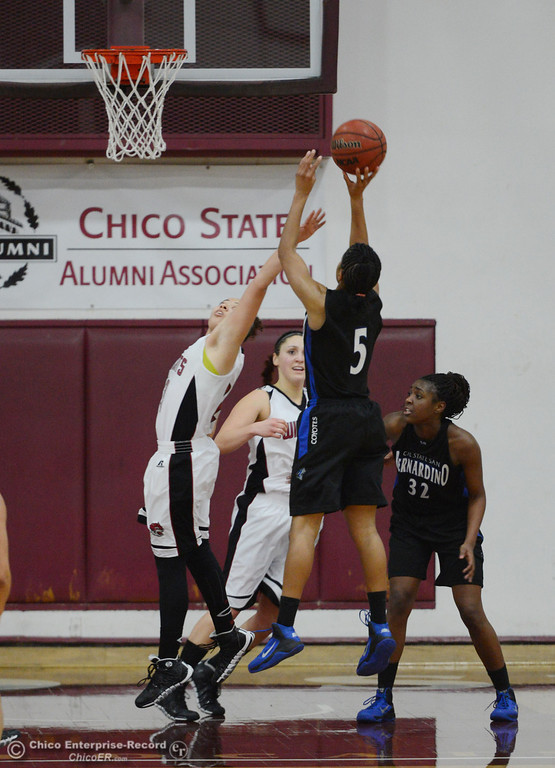 . Chico State\'s #23 Jazmine Miller (left) attempts to block a shot against Cal State San Bernardino\'s #5 Tayllor Gipson (right) in the second half of their women\'s basketball game at CSUC Acker Gym Saturday, February 8, 2014 in Chico, Calif.  (Jason Halley/Chico Enterprise-Record)