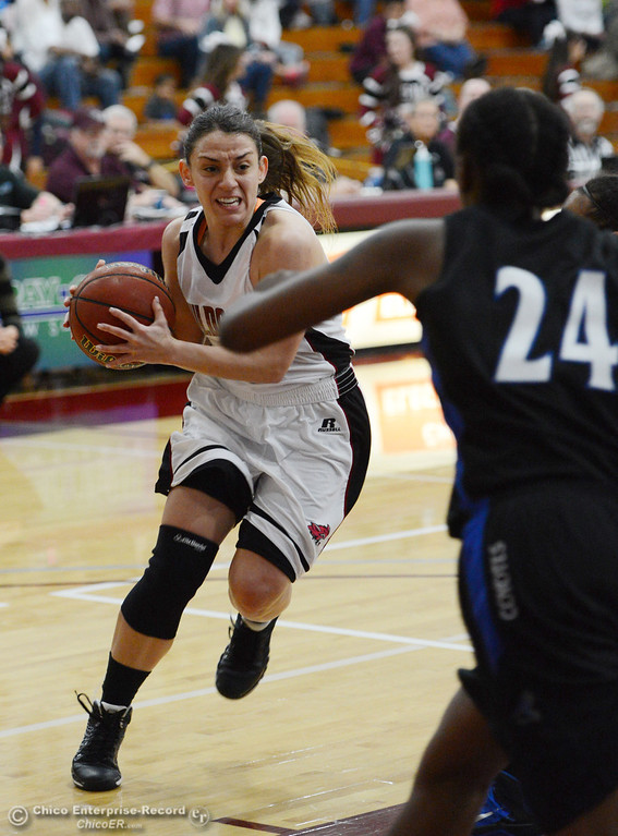 . Chico State\'s #4 Sarah Rebibo dribbles against Cal State San Bernardino in the first half of their women\'s basketball game at CSUC Acker Gym Saturday, February 8, 2014 in Chico, Calif.  (Jason Halley/Chico Enterprise-Record)