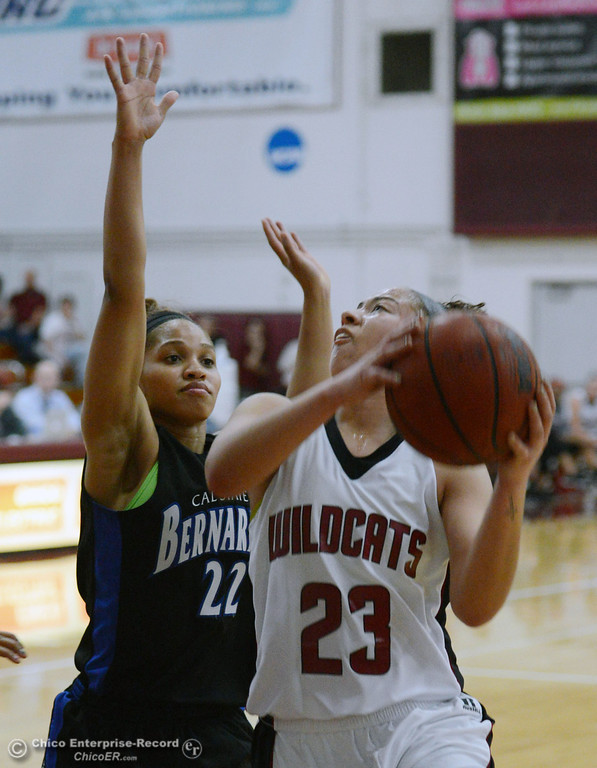 . Chico State\'s #23 Jazmine Miller (right) goes up for a shot against Cal State San Bernardino\'s #22 Briana Baker (left) in the first half of their women\'s basketball game at CSUC Acker Gym Saturday, February 8, 2014 in Chico, Calif.  (Jason Halley/Chico Enterprise-Record)