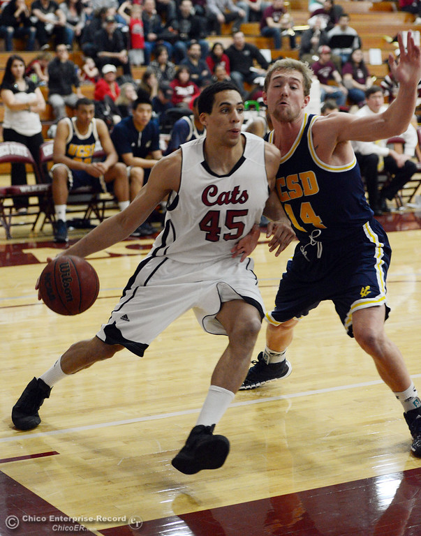 . Chico State\'s #45 Jordan Semple (left) dribbles against UC San Diego\'s #14 Drew Dyer (right) in the first half of their men\'s basketball game at CSUC Acker Gym Friday, February 7, 2014 in Chico, Calif.  (Jason Halley/Chico Enterprise-Record)