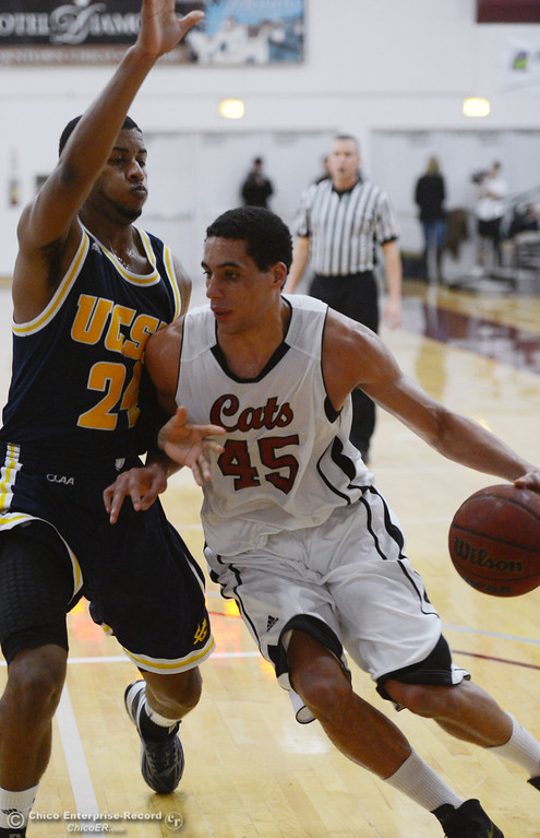 . Chico State\'s #45 Jordan Semple (right) dribbles against UC San Diego\'s #24 Treavon Francis (left) in the first half of their men\'s basketball game at CSUC Acker Gym Friday, February 7, 2014 in Chico, Calif.  (Jason Halley/Chico Enterprise-Record)