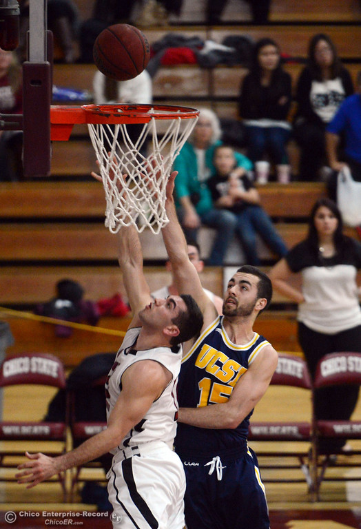 . Chico State\'s #12 Giordano Estrada (left) goes up for a shot against UC San Diego\'s #15 Aleks Lipovic (right) in the first half of their men\'s basketball game at CSUC Acker Gym Friday, February 7, 2014 in Chico, Calif.  (Jason Halley/Chico Enterprise-Record)