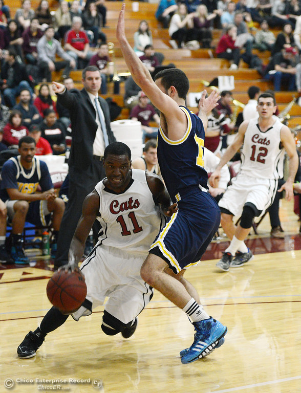 . Chico State\'s #11 Rashad Parker (left) dribbles against UC San Diego\'s #15 Aleks Lipovic (right) in the first half of their men\'s basketball game at CSUC Acker Gym Friday, February 7, 2014 in Chico, Calif.  (Jason Halley/Chico Enterprise-Record)
