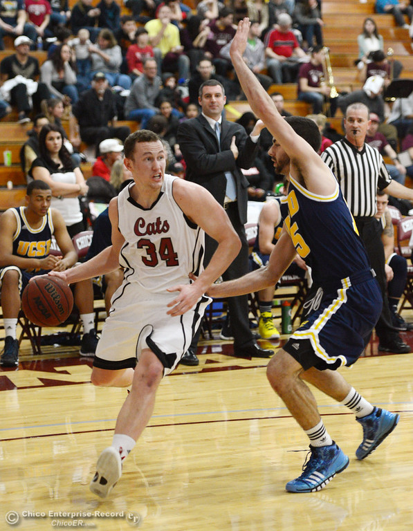 . Chico State;s #34 Drew Kitchens (left) dribbles against UC San Diego\'s #15 Aleks Lipovic (right) in the first half of their men\'s basketball game at CSUC Acker Gym Friday, February 7, 2014 in Chico, Calif.  (Jason Halley/Chico Enterprise-Record)