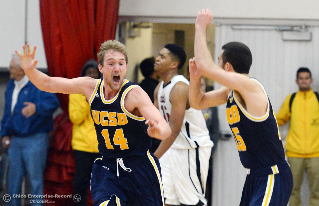 . UC San Diego\'s #14 Drew Dyer (left) reacts to scoring the final shot before the buzzer to celebrating with #15 Aleks Lipovic (right) against Chico State\'s #15 Amir Carraway (back) in the second half of their men\'s basketball game at CSUC Acker Gym Friday, February 7, 2014 in Chico, Calif.  (Jason Halley/Chico Enterprise-Record)