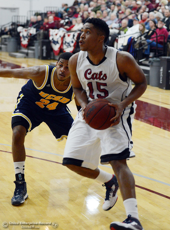 . Chico State\'s #15 Amir Carraway (right) dribbles against UC San Diego\'s #24 Treavon Francis (left) in the first half of their men\'s basketball game at CSUC Acker Gym Friday, February 7, 2014 in Chico, Calif.  (Jason Halley/Chico Enterprise-Record)