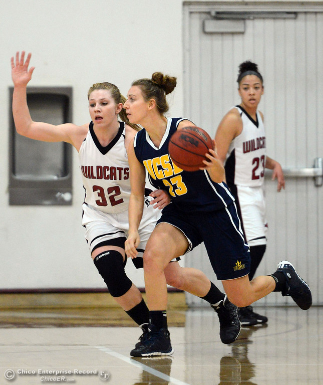 . Chico State\'s #32 Michelle Walker (left) defends against UC San Diego\'s #23 Nadja Kern (right) in the first half of their women\'s basketball game at CSUC Acker Gym Friday, February 7, 2014 in Chico, Calif.  (Jason Halley/Chico Enterprise-Record)