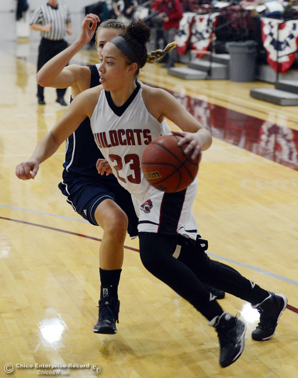 . Chico State\'s #23 Jazmine Miller (front) dribbles against UC San Diego\'s #20 Rachel Marty (back) in the first half of their women\'s basketball game at CSUC Acker Gym Friday, February 7, 2014 in Chico, Calif.  (Jason Halley/Chico Enterprise-Record)