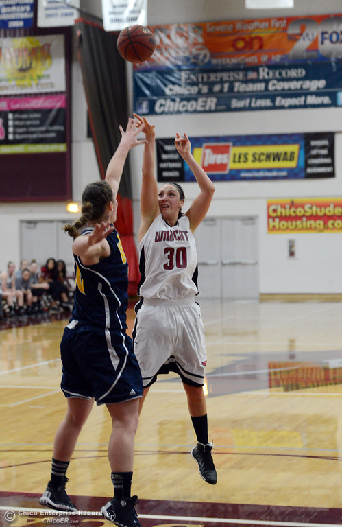 . Chico State\'s #30 McKenzie Dalthorp (right) takes a shot against UC San Diego in the first half of their women\'s basketball game at CSUC Acker Gym Friday, February 7, 2014 in Chico, Calif.  (Jason Halley/Chico Enterprise-Record)