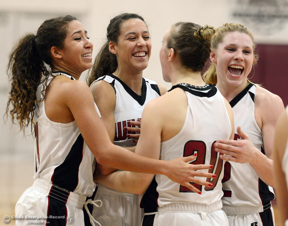 . Chico State\'s #11 Hannah Womack, #21 Courtney Hamilton, #20 Annie Ward, and #32 Michelle Walker (left to right) celebrate their win against UC San Diego in the second half of their women\'s basketball game at CSUC Acker Gym Friday, February 7, 2014 in Chico, Calif.  (Jason Halley/Chico Enterprise-Record)