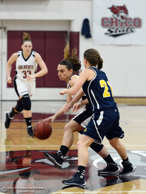 . Chico State\'s #4 Sarah Rebibo (left) dribbles against UC San Diego\'s #21 Megan perry (right) in the first half of their women\'s basketball game at CSUC Acker Gym Friday, February 7, 2014 in Chico, Calif.  (Jason Halley/Chico Enterprise-Record)