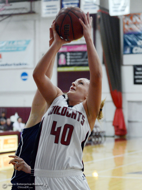 . Chico State\'s #40 Analise Riezebos goes up for a shot against UC San Diego in the first half of their women\'s basketball game at CSUC Acker Gym Friday, February 7, 2014 in Chico, Calif.  (Jason Halley/Chico Enterprise-Record)