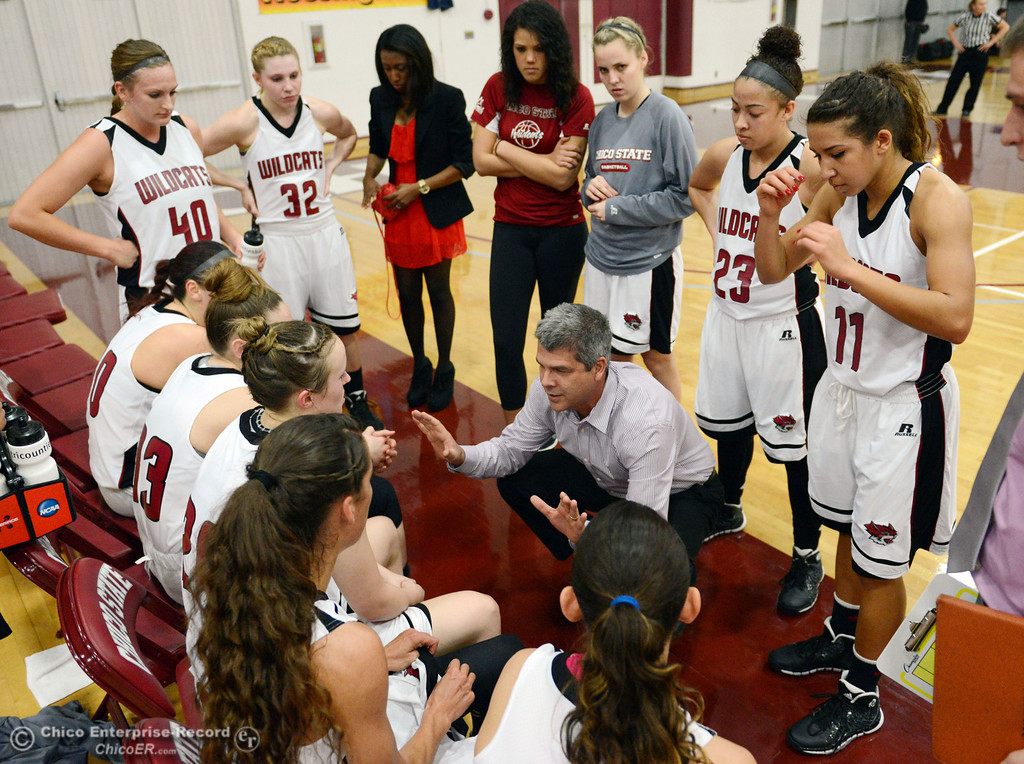 . Chico State head coach Brian Fogel (center) tells the team they\'re still in the game against UC San Diego in the first half of their women\'s basketball game at CSUC Acker Gym Friday, February 7, 2014 in Chico, Calif.  (Jason Halley/Chico Enterprise-Record)