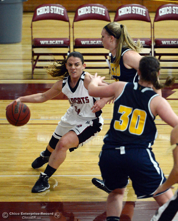 . Chico State\'s #4 Sarah Rebibo (left) dribbles against UC San Diego\'s #24 Haley Anderson (right) and #30 Emily Morris (right front) in the first half of their women\'s basketball game at CSUC Acker Gym Friday, February 7, 2014 in Chico, Calif.  (Jason Halley/Chico Enterprise-Record)
