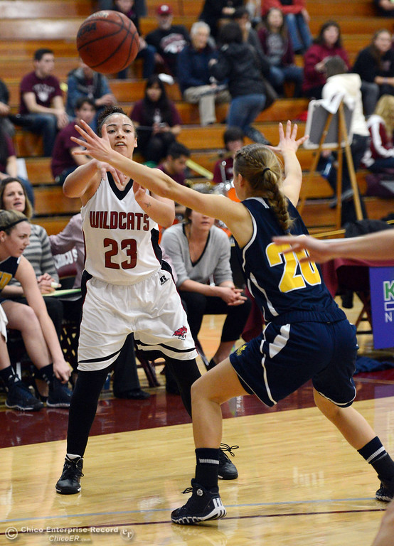 . Chico State\'s #23 Jazmine Miller (left) passes against UC San Diego\'s #20 Rachel Marty (right ) in the first half of their women\'s basketball game at CSUC Acker Gym Friday, February 7, 2014 in Chico, Calif.  (Jason Halley/Chico Enterprise-Record)
