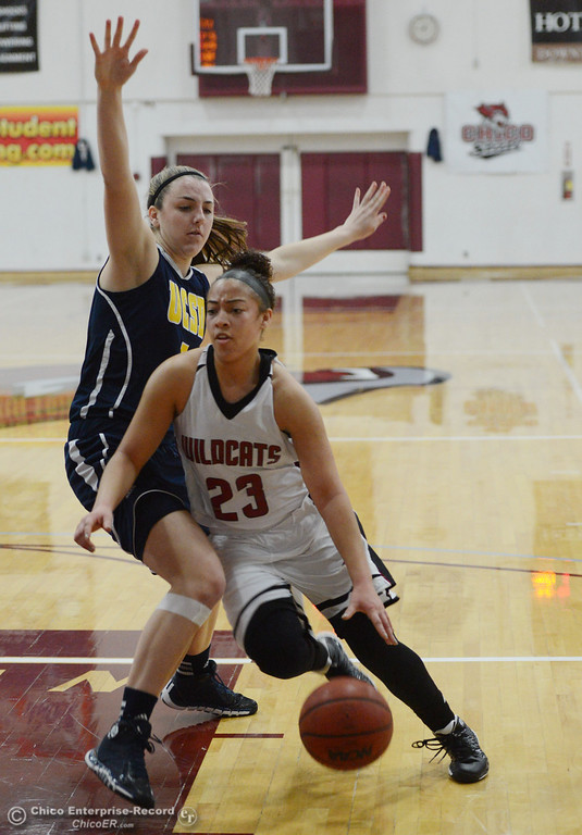 . Chico State\'s #23 Jazmine Miller (right) dribbles against UC San Diego\'s #5 Cassie MacLeod (left) in the first half of their women\'s basketball game at CSUC Acker Gym Friday, February 7, 2014 in Chico, Calif.  (Jason Halley/Chico Enterprise-Record)