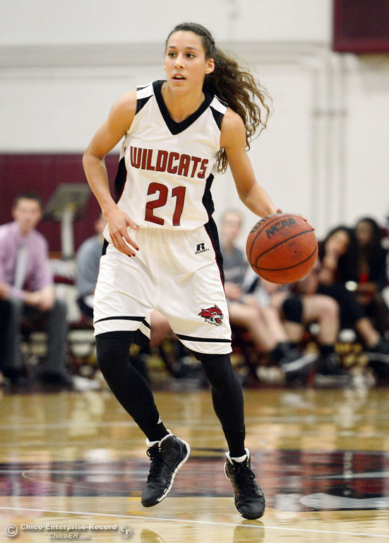 . Chico State\'s #21 Courtney Hamilton dribbles against UC San Diego in the first half of their women\'s basketball game at CSUC Acker Gym Friday, February 7, 2014 in Chico, Calif.  (Jason Halley/Chico Enterprise-Record)