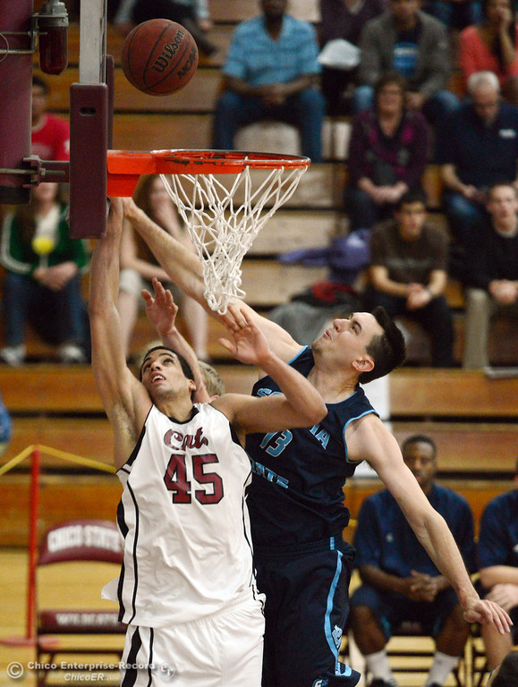 . Chico State\'s #45 Jordan Semple (left) goes up for a shot against Sonoma State\'s #13 Steve Lackey (right) in the first half of their men\'s basketball game at CSUC Acker Gym Friday January 31, 2014 in Chico, Calif. (Jason Halley/Chico Enterprise-Record)