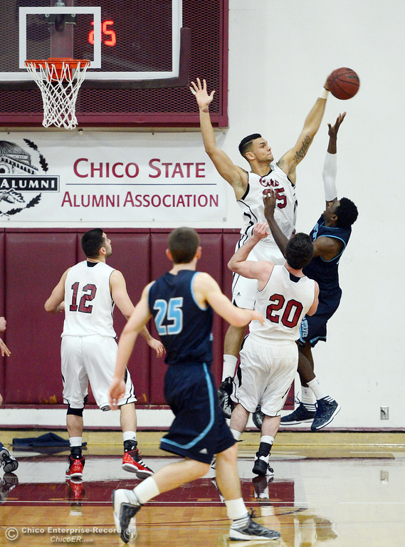. Chico State\'s #25 Chris Magalotti (left) blocks against Sonoma State\'s #33 Sterling Arterberry (right) in the second half of their men\'s basketball game at CSUC Acker Gym Friday January 31, 2014 in Chico, Calif. (Jason Halley/Chico Enterprise-Record)